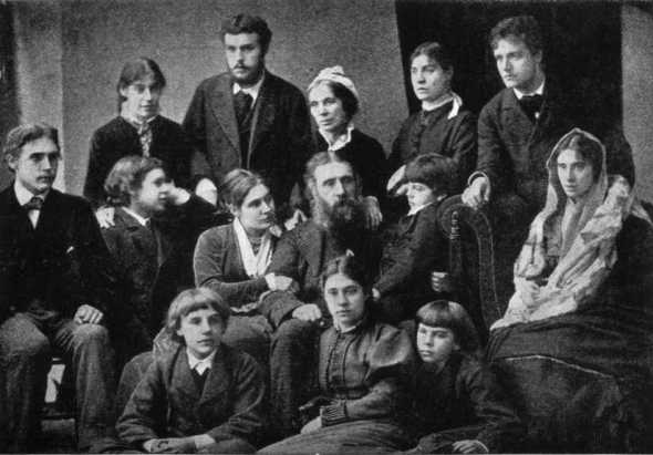 George and Louisa MacDonald, eleven children, and a fianceé, 1876.