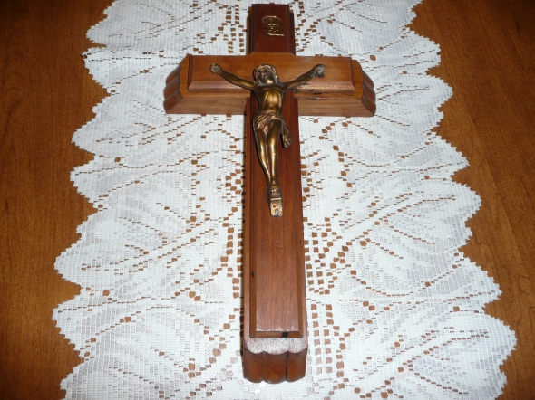 As close as I can remember to the crucifix in my grandparents' home. It is actually a last rites set, explained here.