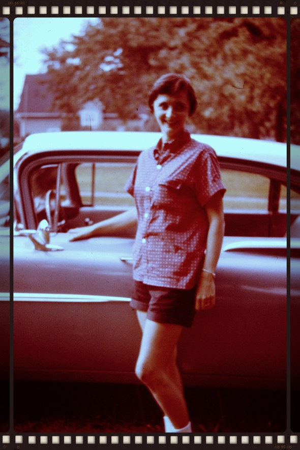 It is hard to find pictures of my mother alone after she's married. This one was taken in 1961 at her parents' house on Schaal Ave. in Erie, PA. She was 29, and the mother of two. I believe the car may be new.