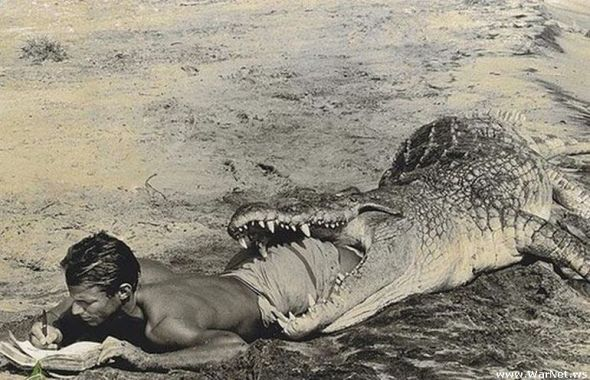 "Peter Beard. ""I'll Write Whenever I Can."" Self-portrait in mouth of crocodile, Kubi Fara. (1965). Check the ""lot notes"" for an interesting story about this picture."