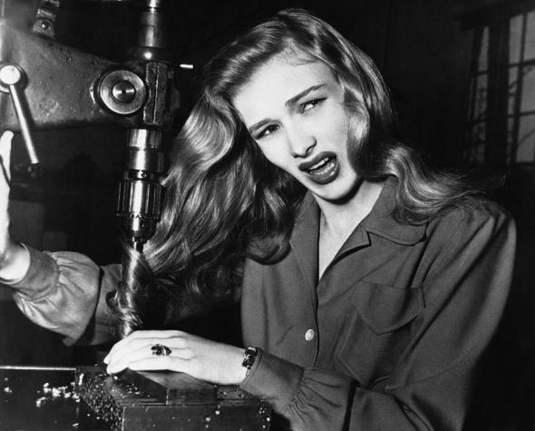 American film actress Veronica Lake, illustrates what can happen to women war workers who wear their hair long while working at their benches, November 9, 1943. AP photo courtesy The Atlantic.