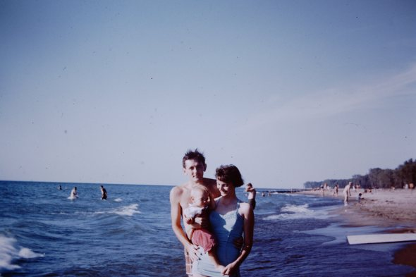 My parents in younger days [1957], with a little me.